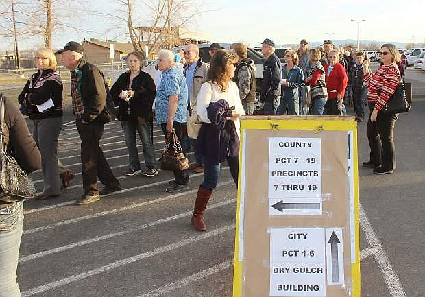 Hundreds of Republican caucus goers wait in line Tuesday at the multi-purpose building.
