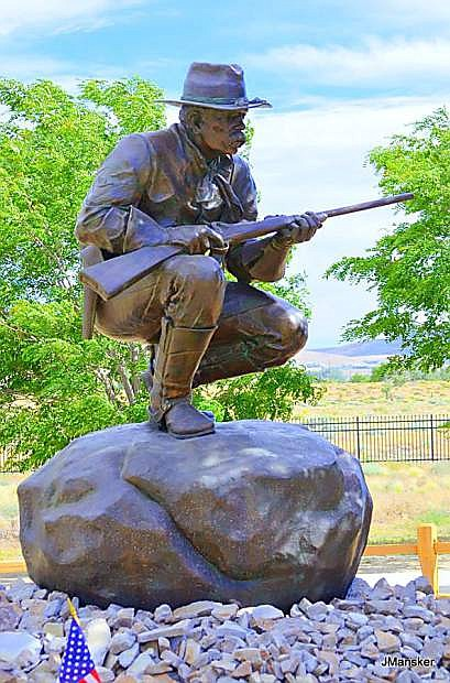 A monument of a cavalry trooper keeps watch on the Northern Nevada Veterans Memorial Cemetery.