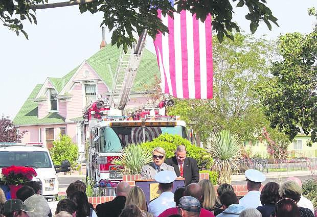 Pastor Woody Swenson opens Frdiay's 9/11 remembrance with a prayer, while Ken Tedford remains in the background.