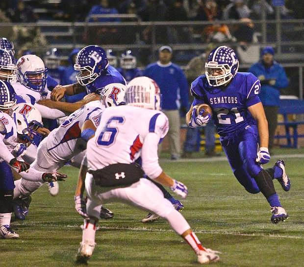 Carson running back Colby Brown (21) runs one up the gut in a win over Reno Friday night at CHS.