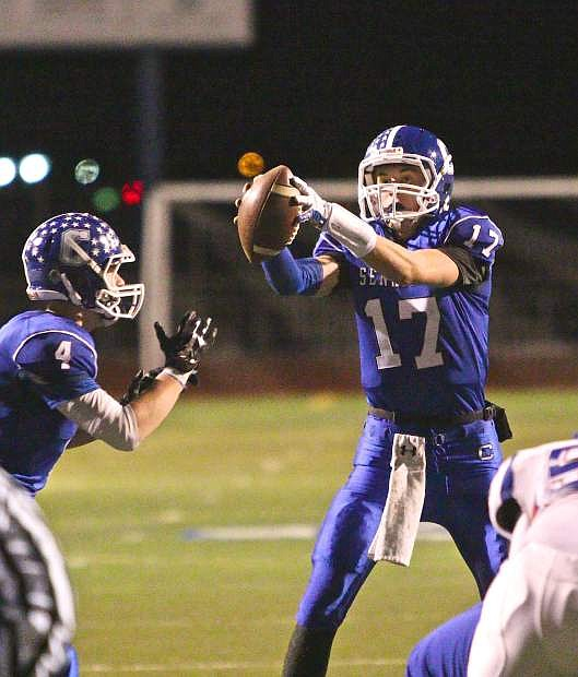 Senator quarterback Joe Nelson (17) takes a snap late in the game in a win over the Reno Huskies Friday night.