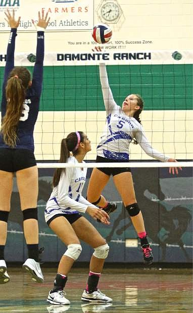 Junior outside hitter Jaycie Roberts (5) drills one back across the net in a 3-0 win over the Damonte Ranch Mustangs Thursday night in Reno.