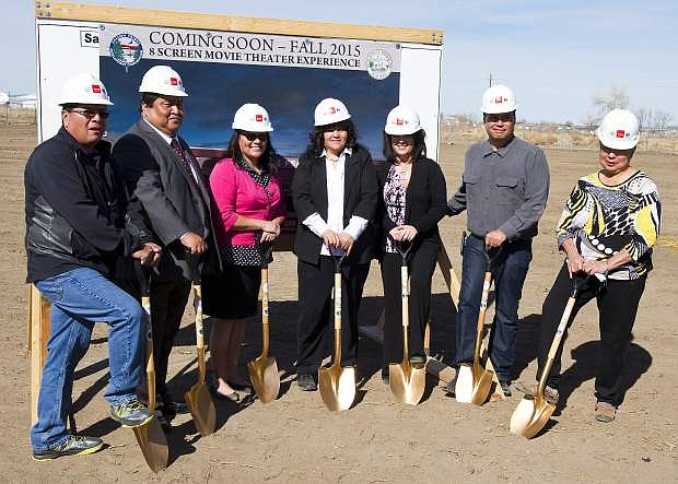 The Fallon Paiute Shshone Tribal Council particiapted in teh grand breaking of a new cincema at Fox Peak. FGromleft are Steve Austinb, Len Goerge,Michelle Bowers,Laura IJames, Yvonne Mori, Jon Pishion and Gayle Miles.