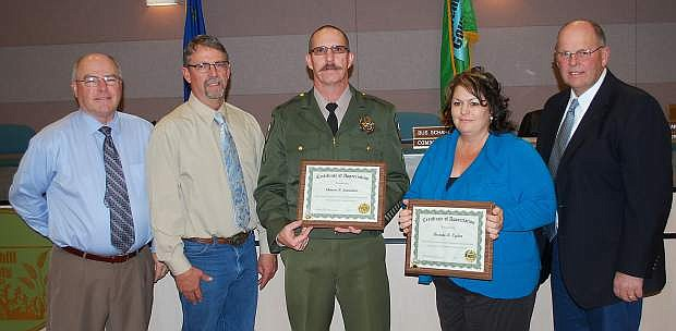 The Churchill County Commissioners handed out the fourth quarter Employee Service Awards. From leftt are Commissioner Bus Scharman, Commissioner Carl Erquiaga, Shawn Summers, Brenda Ogden and Commissioner Pete Olsen. Summers has been a sheriff's deputy for 20 years, and Ogden has been with the District Attorney's office for 20 years. Not present were Daniel Michel, sheriff's office with five years; and Carl Heck, road department, with 25 years.