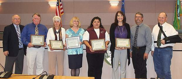 Churchill County Commissioners recognize employees for years of service at their Wednesday commission meeting. From left arecommissioner Bus Scharmann, Judge Mike Richards, Lynda Short, Deborah Kissick, Maureen Smith, Brenda Ingram, commissioner Carl Erquiaga and commissioner Pete Olsen. Marita Hanifen was also recognized for years of service but not present at the time of the photograph.