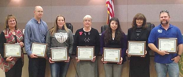 From left, Alethea Steuart, Preston Denney, Marcie Compav, Terri Pereira, Cecilia Sanchez, Naomi Clay and Gary Rothery were recognized for their years of service with Churchill County.