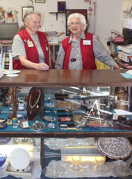 Store manager JoAnne Baumgart, left, and volunteer Caroline Briggs have worked the counter this week at the Community Service Thrift Store. The shop closes its doors today.