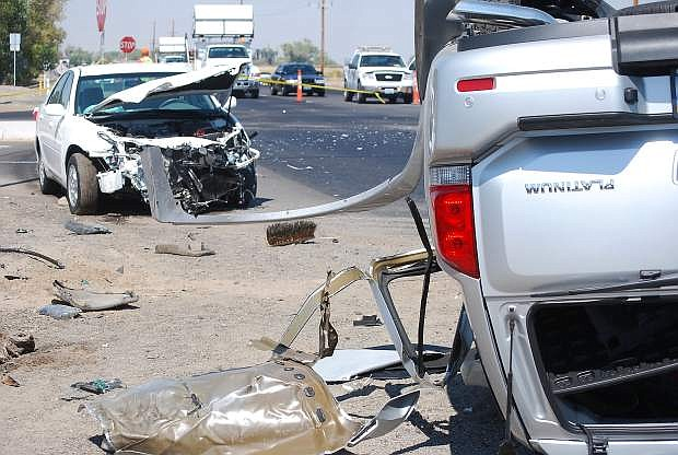 A two-vehicle accident Wednesday morning seriously injured a state worker in a construction zone on the Reno Highway  and also both drivers and  passengers from one of the cars.