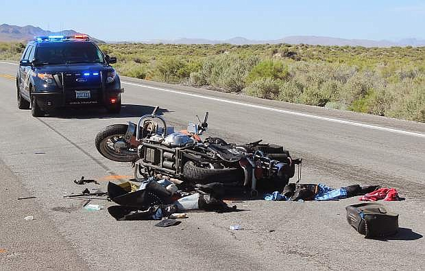 A Washington state man was killed Sunday when his motorcycle and a pickup colllided near Grimes Point.