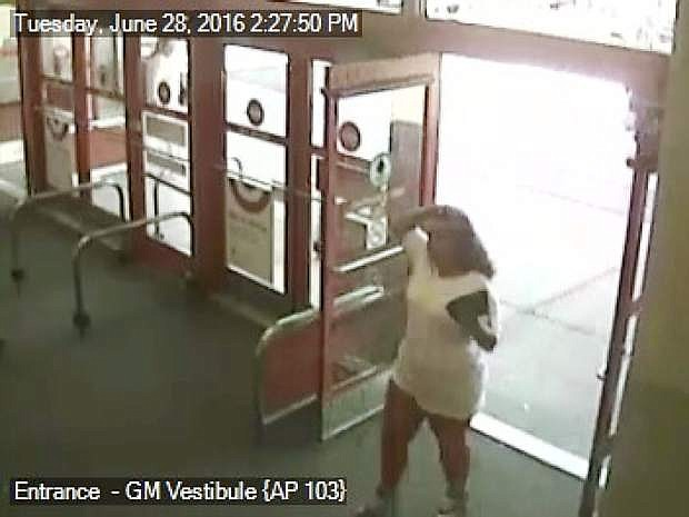 A woman seen entering the Target on June 28 is a person of interest in the theft and use of credit cards.