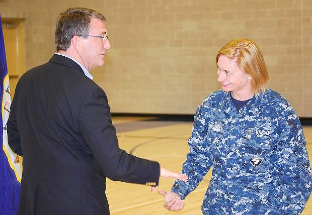 Deputy Secretary of Defense Ashton Carter presents a coin to ADAN Adriana Makerney during his visit to Naval Air Station Fallon on Tuesday.