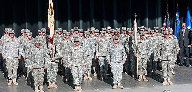 A deployment cremony was conducte last wek in Reno for the 757th Combat Sustainment and Support Battalion. At right is Gov. Brian Sandoval.