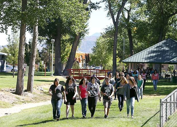 Carson High School freshman walk through Mills Park on their way to work in the Digitorium at the Carson City Library on Wednesday.