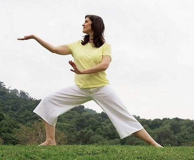 Tai chi can reduce pain, stiffness and fatigue. / Eric O'Connell, Getty Images