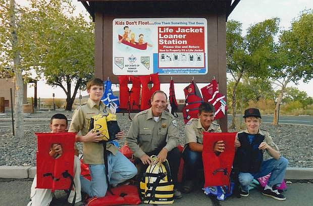 Presentation ceremony of the finished water safety kiosk and life preserver loaner station occurred at the North Shore Marina. From left  at Shore Marina are Jesse David Watkins, Aaron McCormick, Anthony Beauregard from the Lahontan State Park, Mitchell Whitaker, and Robbie Mortensen. Not pictured are Kaleel Rickerson, Cord Hendrix, Caleb Hendrix, Destry Edwards and Scout Master Daniel Perazzo.