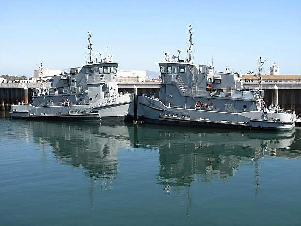 The 74-foot Army tugboats Desert Storm and Sag Harbor occupy pier spaces at Naval Base Ventura County adjacent to the Palo Alto.