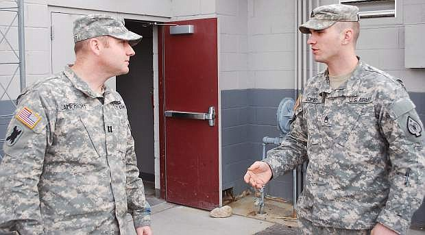 Capt. Joannes Lamprecht, left, the new commander of the 609th Combat Engineer Co., listens to one of his soldres, Staff Sgt. xxxxxxxxx