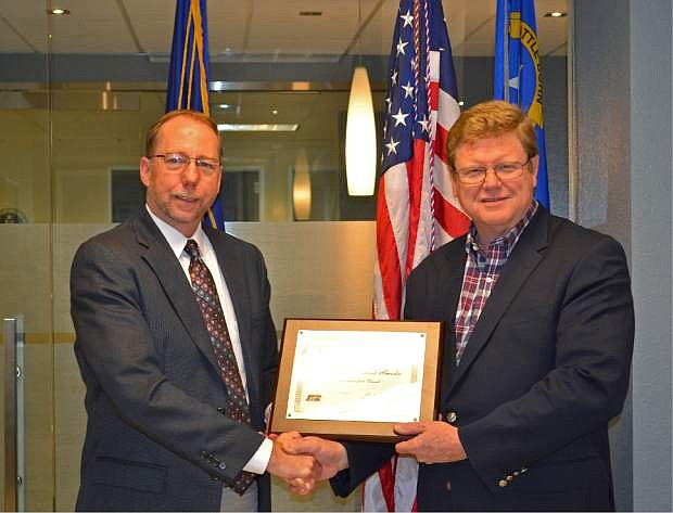 Nevada Farm Bureau Executive Vice President Clay McCauley presents Congressman Mark Amodei the Friend of Farm Bureau Award.