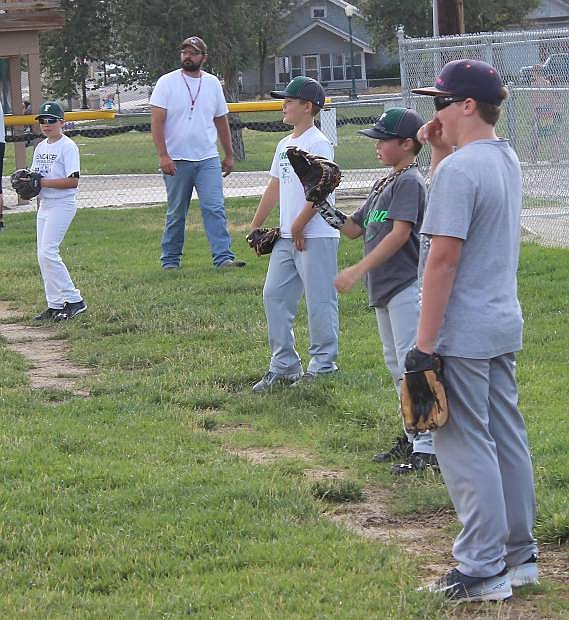 Baseball coach Jeff Prinz, left, surveys his players during practice on Wednesday. Many players share his feelings that Father's Day is more than one day of the year to honor dad; it's 365 days a year.