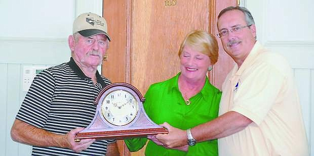 Fallon Mayor Ken Tedford Jr., right, presents on Wednesday a retirement clock to Fern Lee, who spent 19 years with the city. Looking on is Rich Lee.