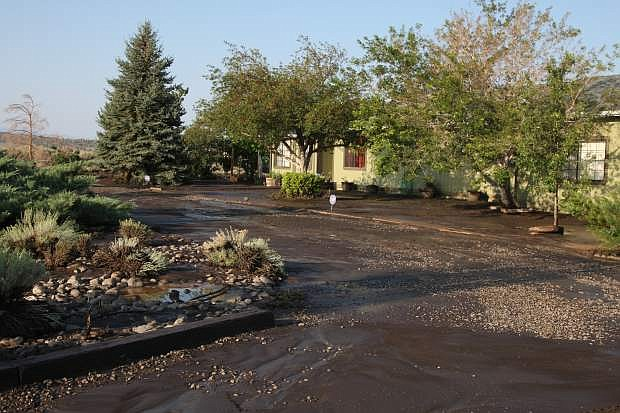 This property at 1358 Windmill had a good portion of the yard washed away by the flood waters Wednesday night.