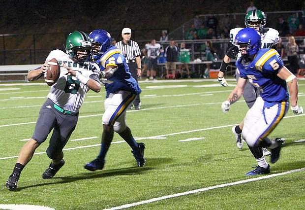 Fallon backup quarterback Joe Pyle attempts to avoid a South Tahoe defender during last week's game.
