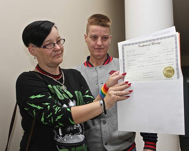 Kristy Best and Wednesday Smith show off their marriage license at the Carson City Courthouse Thursday. They were the first same-sex couple to receive a license in Carson City.