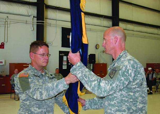 Col. Dan Waters, right, receives the colors of the 991st Troop Command from Army Guard deputy commander Col. Mike Hanifan on July 14 in Reno. Hanifan, who grew up in Fallon, will have his own change of command on Sept. 7 when he becomes the state's new Commander Army Guard.