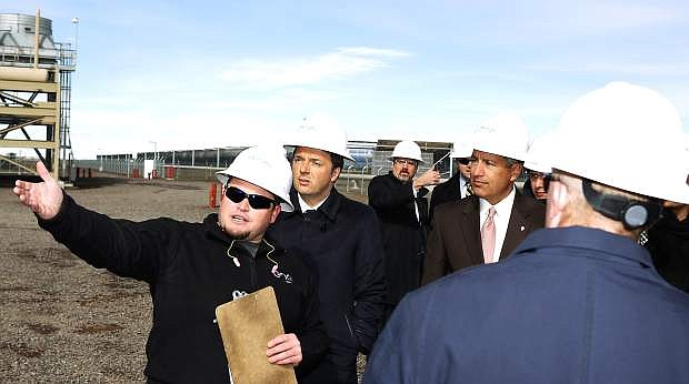 Brian Stankiewicz, left, gives on Tuesday Italian Prime Minister Matteo Renzi, center, and Nevada Gov. Brian Sandoval a tour of the Stillwater Hybrid Power Plant.