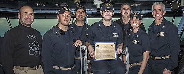 Stephen Gilbert of Fallon (with certificate) was nbamed Sailor of the Day aboard the aircraft carrier USS Carl Vinson.