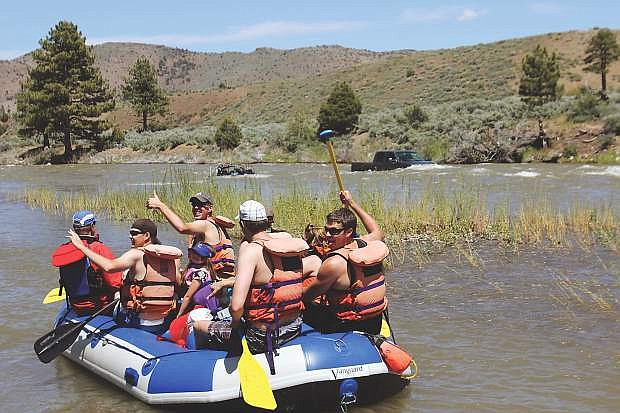 A group of happy rafters take off down the Carson River in this file photo..