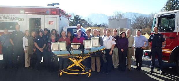 Members of the Douglas Healthcare Coalition pose with a 12-lead cardiac monitor, a proclamation from Gov. Brian Sandoval for East Fork Fire and Tahoe Douglas Fire along with the Heart Safe Community awards.
