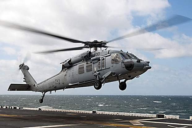 An MH-60S Sea Hawk helicopter takes off from the flight deck of the amphibious assault ship USS Kearsarge (LHD 3). A helicopter similar to this one crashed in Dixie Valley on Tuesday.
