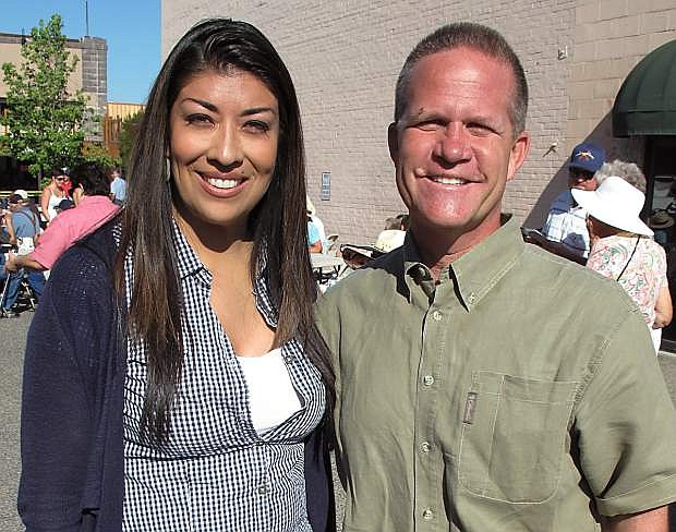 Lieutenant governor candidates Lucy Flores and Mark Hutchison take a moment away from the politics at the Kiwanis sLabor Day breakfast in Fallon.