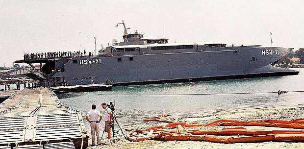 This photo, taken at the San Diego Navy Base in August, 2002, is of the HSV-XI, the first Joint High Speed Vessel that is identical to the USNS Carson City.