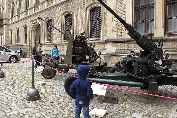 A small boy examines Czech Army WW II anti-aircraft canon displayed outside Prague Castle throughout 2015 to commemorate the 70th anniversary of the end of the war.