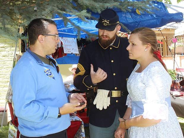 Jon Yuspa, left, founder and CEO of Honor Flight Nevada, speaks to Chris Parker and Whitney Brunson at the recent chili cook-off in Carson City.
