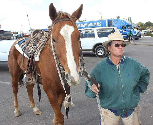 Colleen Rupp-Kness of Twin Falls, Idaho, exercises her horse durng a stop in Fallon. She and otehr riders met another teamof riders east of Lovelock later in the day.