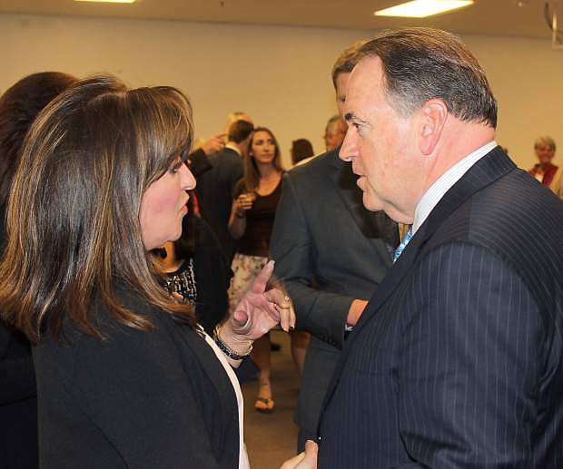 Former Arkansas Gov. Mike Huckabee and Cheri Wood have a conversation during his Carson City stop in late March. Huckabee will be in Fallon on Monday morning.