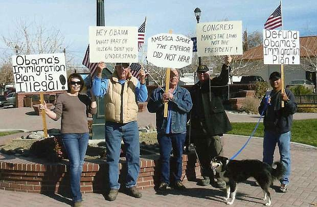 Fallon Tea Party memebrs protested President Barack Obama's executive action that granted amnesty to about 5 million undocumented aliens. Fromleft are  Amber Sanchez, Jim Falk, Rupert Wyble, Ed Martinez and Rick Sanchez.  The dog is named Sadie.