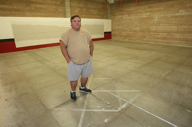 Pat McKinnish, owner of Guns N Ammo stands in a space that he would like to build a 25-yard indoor gun range.