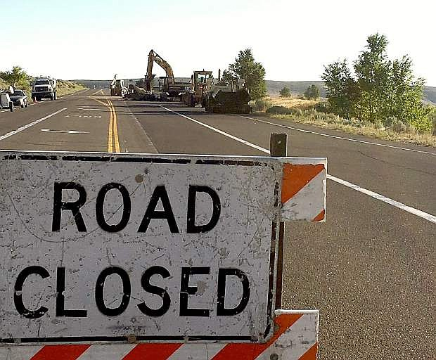 Crews started filling in the hole on Jacks Valley Road on Wednesday. The road was expected to reopen by 7 p.m.