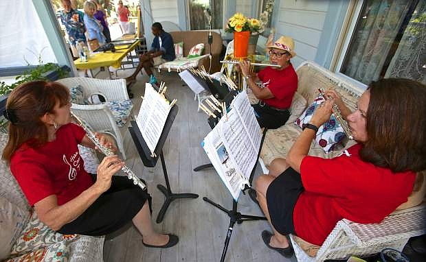 Clockwise from left: Nancy Irwin, Betsy Garfinkle and Jane Dykstra, The Triple Treble Flute Trio , perform on the veranda of the Bliss Mansion Friday evening during the opening performance of 'Jazz and Beyond.'