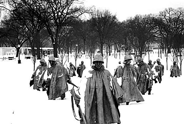 The Korean War Memorial takes on an eerie look of combat reality as photographed following a blizzard in Washington, D.C. in January 1996.