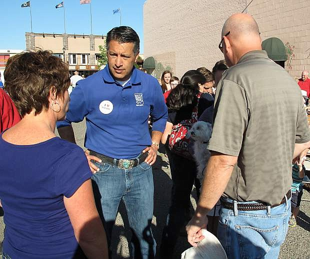Gov. Brian Sandoval listens to consitutents on Monday at the Kiwansi Labor Day pancake breakfast.