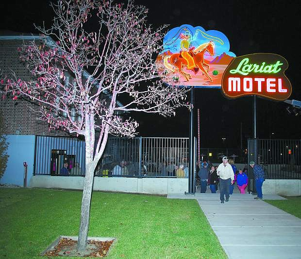 The re-lighting of the Lariat Motel sign kicked off the city's involvement with Nevada's 150th birthday celebrtions that will last until Oct. 31, 2014.