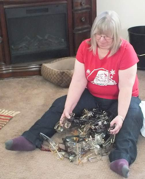 Fallon Lions Club member Vicki Bushek sits and counts each and every pair that we pick up from our local drop centers for recylcling our glasses.