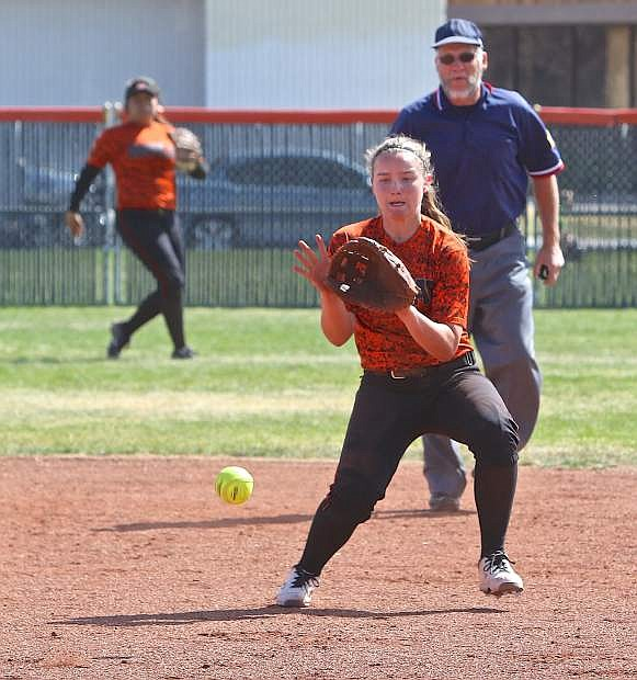 Douglas shortstop Allison Meyer scoops up a grounder in a loss to Reed on Saturday at DHS.