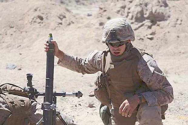 A Marine loads a 60 mm mortar during training at Hawthorne Army Depot,  in July 2011. A military investigation into the deadly mortar accident at HAWD  10 months ago concludes the explosion resulted from human error, due in part to inadequate training and some Marines' lack of familiarity with the weapons system.