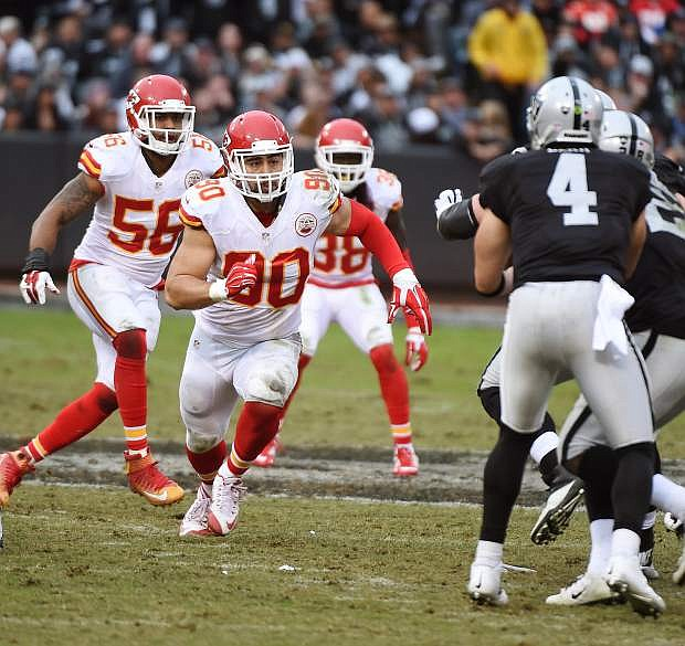 Fallon's Josh Mauga (90), a linebacker for the Kansas City Chiefs, takes aim on Oakland quarterback Derek Carr (4) almost two weeks ago.